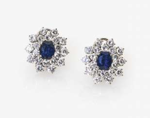 A Pair of stud prong plug with diamonds and sapphires
