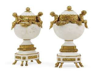 A PAIR OF FRENCH ORMOLU-MOUNTED MARBLE URNS