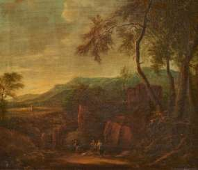 Italian landscape with hikers in front of a rock