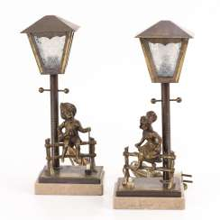 Pair of bedside lamps with figures of children