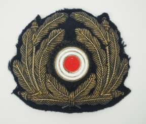 Navy: cockade and oak leaf wreath for the peaked cap.