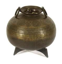 Large, ball-shaped metal basin with a circular Arabic inscription