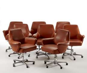 * Lot of eight small armchairs on wheels covered in Siena-colored leather
