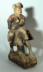 Chinese wooden sculpture of a horse rider with painted and decorated textile cover