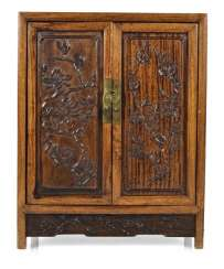 Small Cabinet made of hard wood with carved and seven relapses