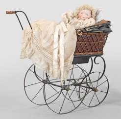 "Large ""Bye-Lo-Baby"" by Grace Storey Putnam with a doll's pram"