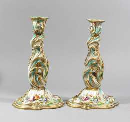 Two Porcelain candlesticks, curved shape, painted, 19. century