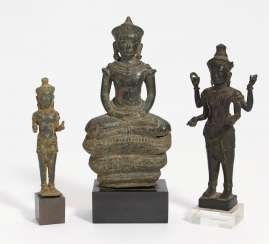 Two standing figures and Buddha on a snake throne
