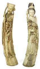 Two large, finely-carved ivory figures, partially black