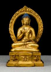 Fire-gilt Bronze of Buddha Akshobya on a throne