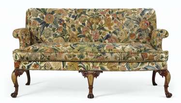 A GEORGE II WALNUT AND PARCEL GILT SETTEE