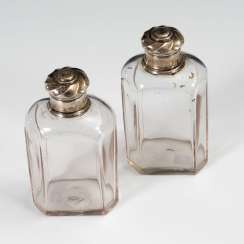 2 glass bottles with silver lid.