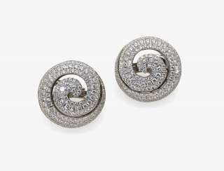 A Pair of ear plug with diamonds