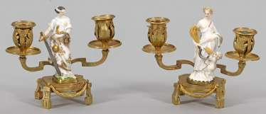 Pair of candlesticks with allegorical Meissen figures