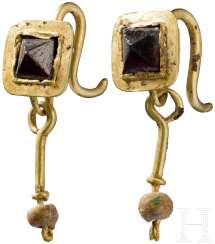 Earring pair is made of Gold with Garnet inlays and beads, Roman, 2. - 3. Century