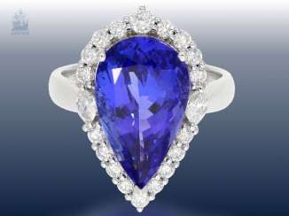 Ring: very attractive, high quality gold ring with a large tanzanite top quality as well as fine diamonds, unworn wrought