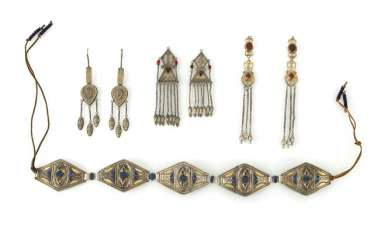Three pairs of earrings and a belt made of silver, some in Kazak style