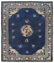 Wool carpet with a Buddhist lion and two Central Phoenixes on a blue Fond