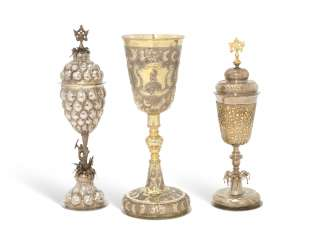 A PARCEL-GILT SILVER CHALICE AND TWO PARCEL-GILT SILVER CUPS AND COVERS