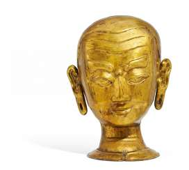 Larger-than-life head of a Buddhist monk