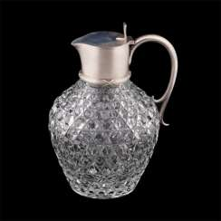 A decanter. Silver, crystal carving