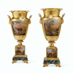 A PAIR JACOB PETIT PORCELAIN GOLD AND FAUX JASPER GROUND VASES ON FIXED STANDS