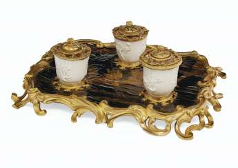 A LOUIS XV ORMOLU-MOUNTED BLACK AND GILT-LACQUER AND CHINESE DEHUA CUPS ENCRIER