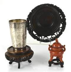 Silver cups, and incense burners, and two wood stands