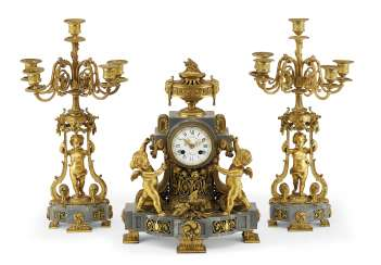 A FRENCH ORMOLU AND BLEU TURQUIN MARBLE THREE-PIECE CLOCK GARNITURE