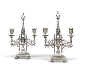 A PAIR OF WHITE-METAL TWIN-LIGHT CANDELABRA