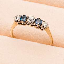 Rivièrering with diamonds and sapphires