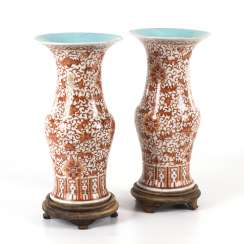 Large pair of vases decorated in coral red