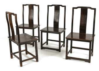 Four taught chairs made of hard wood