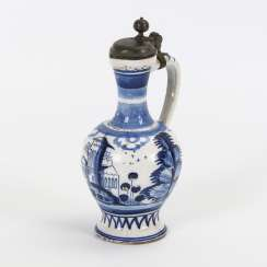 Small faience narrow-necked jug with architecture