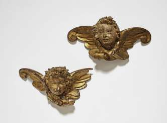 A Pair of winged angels ' heads, South German, around 1620