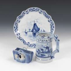 Jug, cat, case, and tray with Delft blue decor