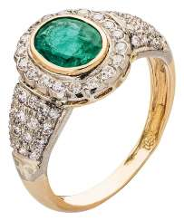 Vintage entourage ring with emerald and diamonds