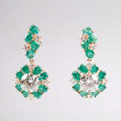 Outstanding pair of diamond and emerald earrings.