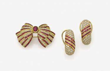 Demi Parure, brooch in loop shape, and a Pair of clip-on earrings/plugs with rubies and diamonds. Probably Germany