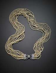 Eight strand natural saltwater pearl necklace with white gold diamond in all ct. 3 circa and pear sapphire clasp