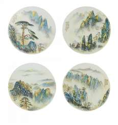 Four round plates with landscapes of the Huangshan mountains