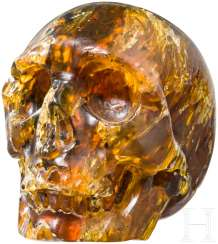 Memento-Mori-skull in amber, the Baltic region, around 1900