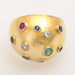 Extravagant ladies ring with precious stones,