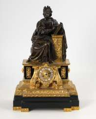 Ornate Bronze mantel clock with a tight figure