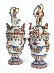 A PAIR OF VIENNA (DU PAQUIER) PORCELAIN VASES AND COVERS EMB...