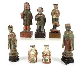 Five wood, and two porcelain figures