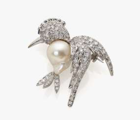 Fancy bird brooch with diamonds, rubies and a sapphire