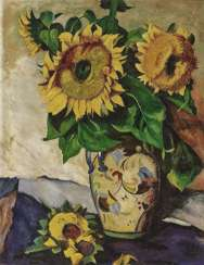 Sunflowers in a painted vase with double handles. Around 1926
