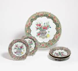 Large and four small plates with a flower basket with peonies