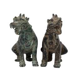 Pair of Asian guardian lions made of bronze.